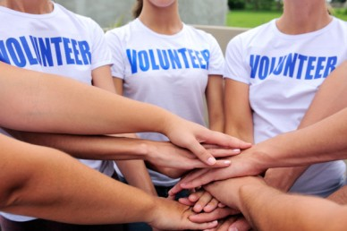 depositphotos_10961902-stock-photo-volunteer-group-hands-together